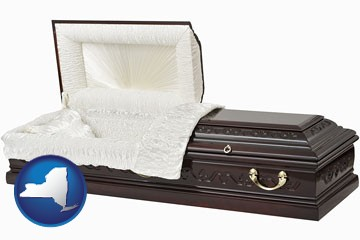 an open funeral casket - with New York icon